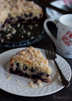 Lemon Blueberry Coffee Cake - Tender, wet lemon coffee dessert loaded with blueberries crowned with a crunchy, nice crumb topping and drizzled with a tart lemon glaze.