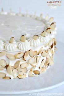 Perfect White Cake meal topped with an Amaretto Cream Cheese frosting and toasted almonds. YUM!!!