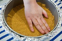 use your hands to press straight down graham cracker crumbs